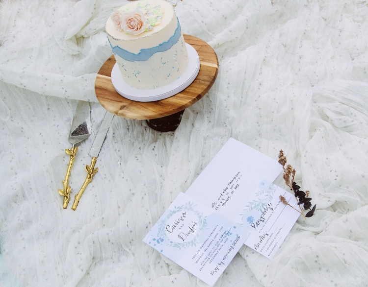 The planner set up a little picnic area for the cake and stationery to be set up. The colors of the cake and stationery match perfectly and let me tell you about the cake... It was DELICIOUS! Tiny bits of caramel pieces in the middle and so much chocolate filling... perfection! 😋